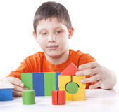 Boy playing toy blocks Stock Photos