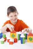Boy playing toy blocks Stock Photo