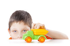 Boy playing with toy car Royalty Free Stock Photo