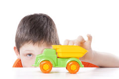 Boy playing with toy car Stock Image