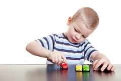 Boy playing with toy cars Royalty Free Stock Images