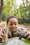 Boy playing with toy dinosaurs Royalty Free Stock Photos