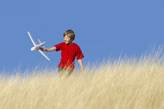 Boy Playing With Toy Glider Airplane Stock Images