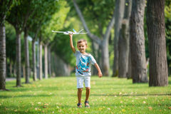 Boy playing with toy glider in park Stock Photography