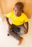 Boy playing toy gun Stock Images