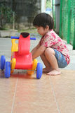 Boy playing toy horse Stock Photo