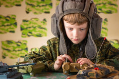 Boy playing toy military tank Royalty Free Stock Photography