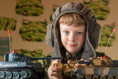 Boy playing toy military tank Royalty Free Stock Photo