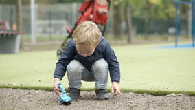 Boy playing with toy outdoor. stock video
