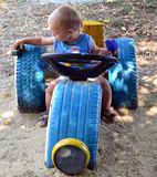 Boy playing a toy. Oy playing toy in the playground with a machine with car tires Royalty Free Stock Photo