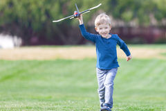 Boy playing toy plane Royalty Free Stock Photo
