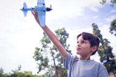 Boy playing with a toy plane at park Royalty Free Stock Photo