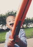 Boy playing toy rifle Royalty Free Stock Photo