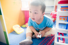 Boy playing with toy scaner Stock Photo