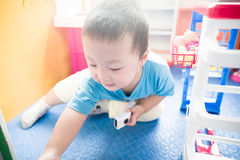 Boy playing with toy scaner Royalty Free Stock Image