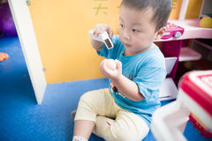 Boy playing with toy scaner Stock Photography