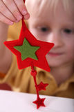 Boy playing with toy star Stock Image
