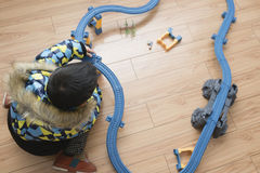 Boy playing toy train Royalty Free Stock Images