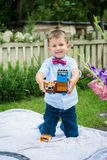 Boy playing with toy train Stock Photos