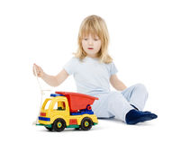 Boy playing with toy truck Royalty Free Stock Photo