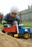 Boy playing with toy truck outdoor Stock Photos