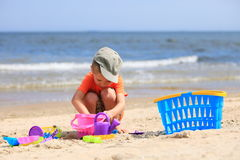 Boy playing toys on beach Royalty Free Stock Photography