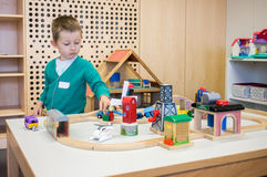 Kindergarten boy playing with toys Royalty Free Stock Photography