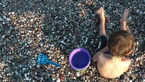Boy Playing with toys near the Seaside Royalty Free Stock Photo