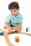 Boy playing with train Royalty Free Stock Images
