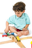 Boy playing with train Royalty Free Stock Photography