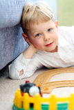 Boy playing with train Royalty Free Stock Photos