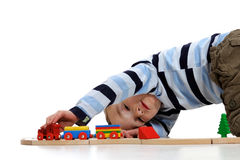 Boy playing with a train set royalty free stock image