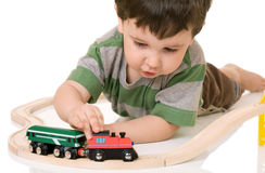 Boy playing with a train set Royalty Free Stock Photo