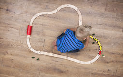 Boy playing with train Stock Images
