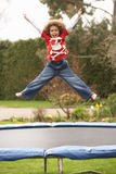 Boy Playing On Trampoline Stock Images
