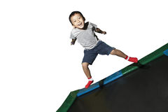 Boy playing on a trampoline Royalty Free Stock Images