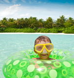 Boy playing in tropical ocean Stock Image