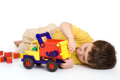 Boy playing with truck and blocks Royalty Free Stock Photo