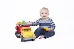 Boy is playing with truck Stock Photo