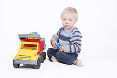 Boy is playing with truck Stock Image