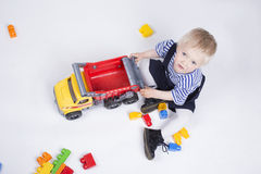 Boy is playing with truck Royalty Free Stock Photo