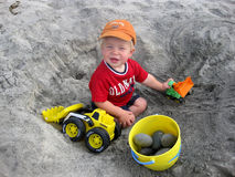 Boy playing with trucks at the beach Stock Photography