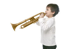 Boy playing on a trumpet Royalty Free Stock Photos