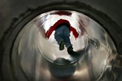 Boy playing in a tube slide Royalty Free Stock Photos