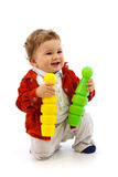 Boy playing with two skittles Royalty Free Stock Photo