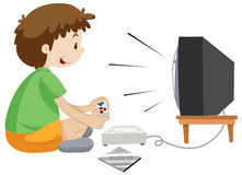 Boy playing vdo game alone Royalty Free Stock Images