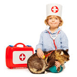 Boy playing veterinarian with stethoscope and cat Royalty Free Stock Images