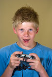 Boy playing a video game Royalty Free Stock Photo