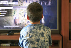 Boy playing video game console Royalty Free Stock Images