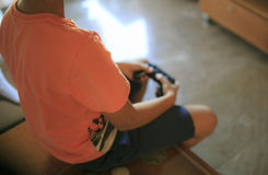 Boy playing video game console Royalty Free Stock Image